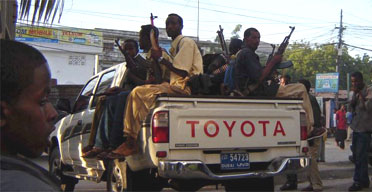 Somali militiamen go on a patrol of Mogadishu earlier this year. Photo: Albadri Abukar, EPA
